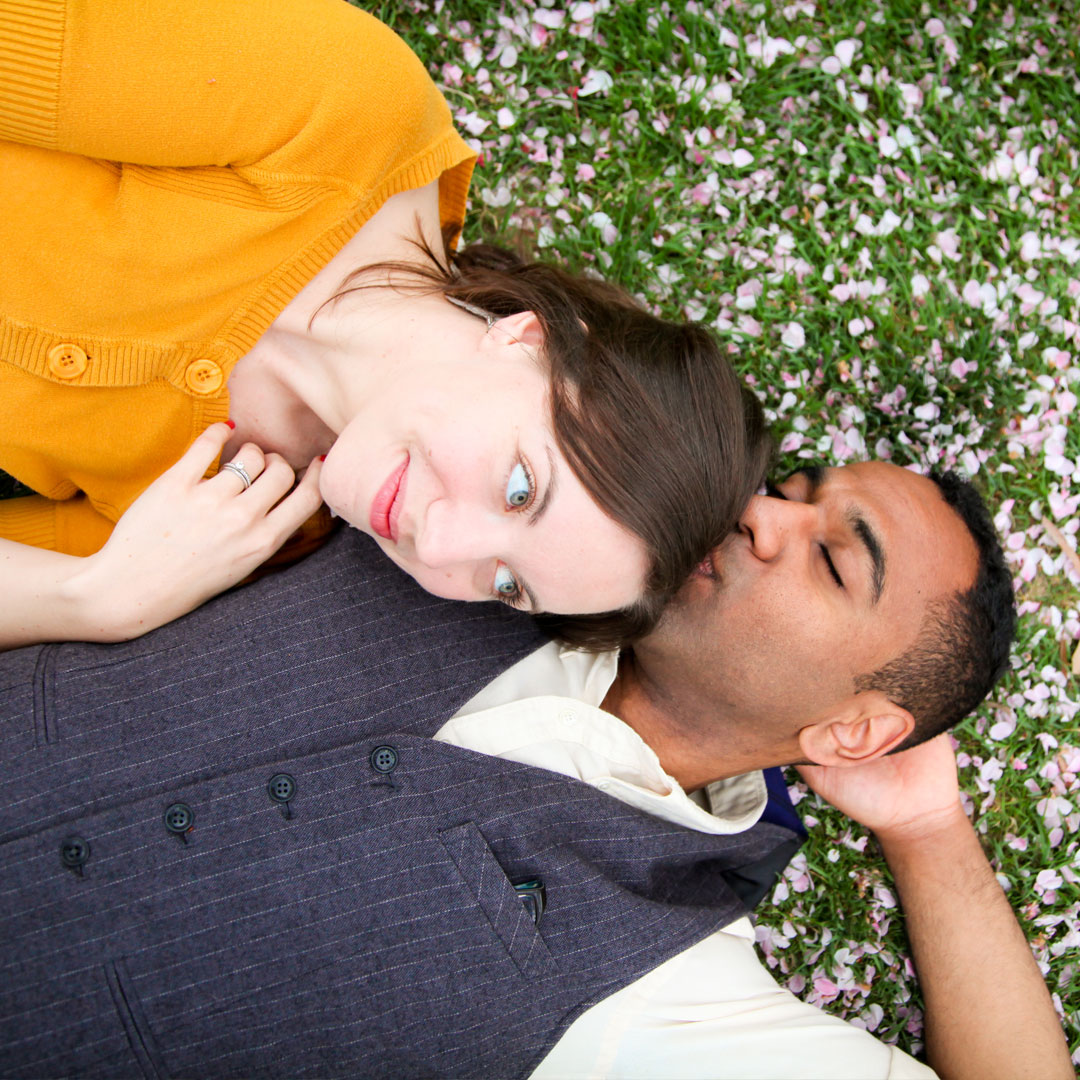 Lifestyle photography, couples photography, couple laying in grass