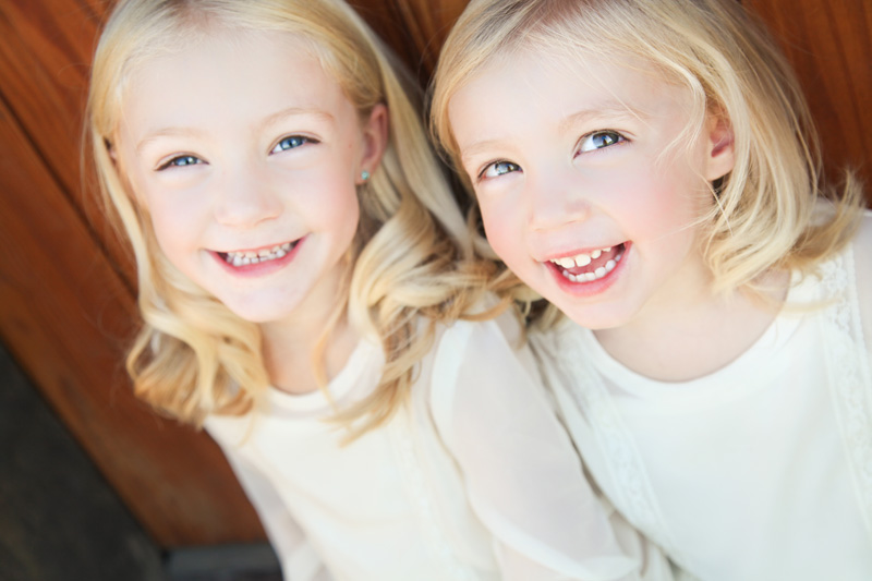Family Photography and Milestone Photography, young blonde twin sisters