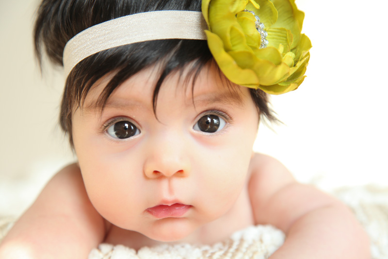 Family Photography and Milestone Photography, little girl with yellow flower headband