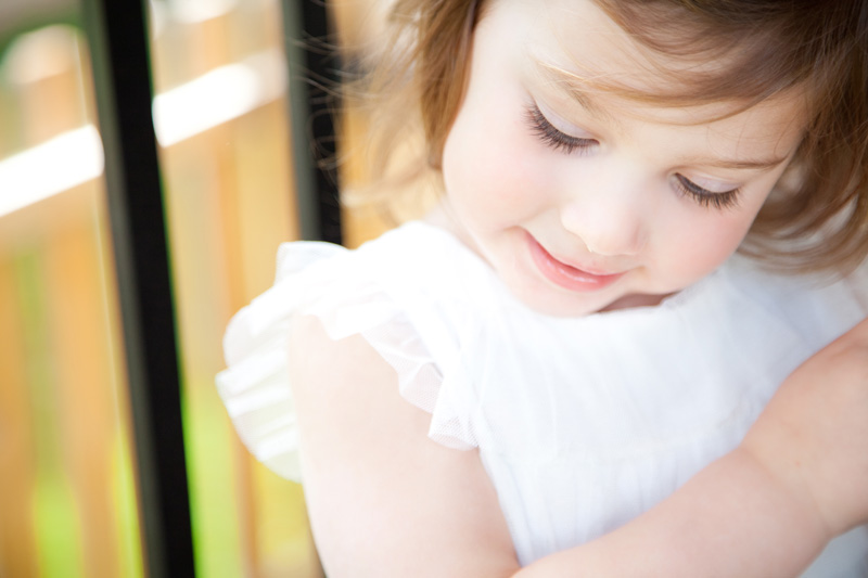 Family Photography and Milestone Photography, close up of little girl in white dress