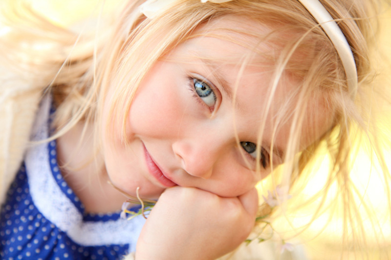 Family Photography and Milestone Photography, close up of little blonde girl