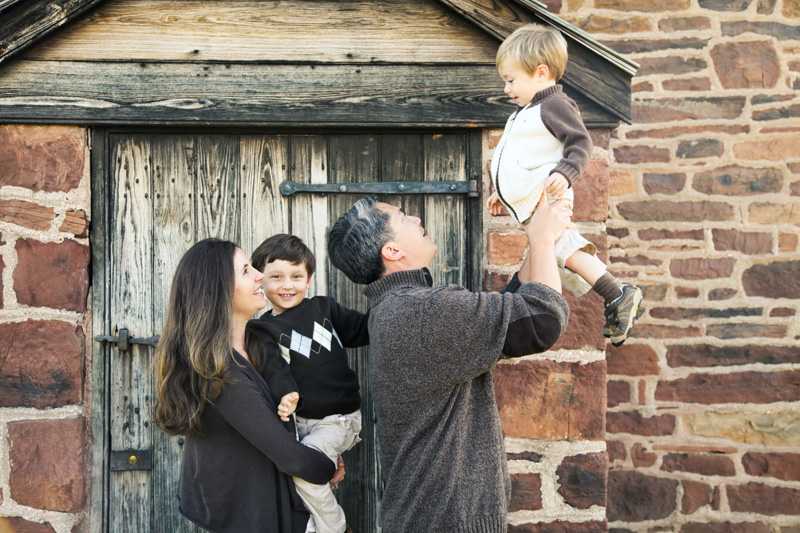 Family Photography and Milestone Photography, family in front of old rock building