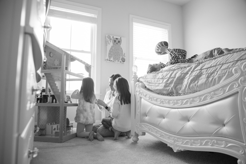 Family Photography and Milestone Photography, mom and daughters play with doll house