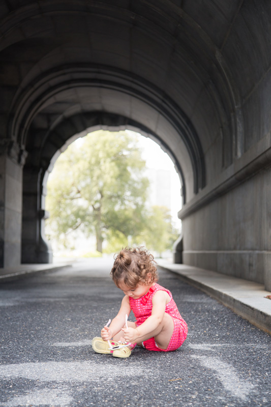 Family Photography and Milestone Photography, little girl sitting in tunnel