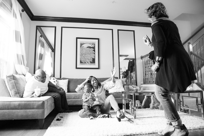Family Photography and Milestone Photography, family playing in livingroom