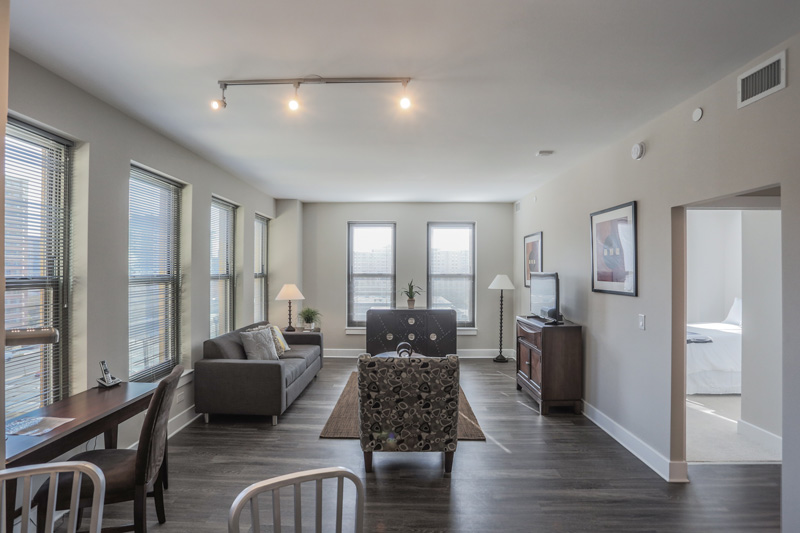 Real Estate Photography, narrow livingroom with hallway to bedroom