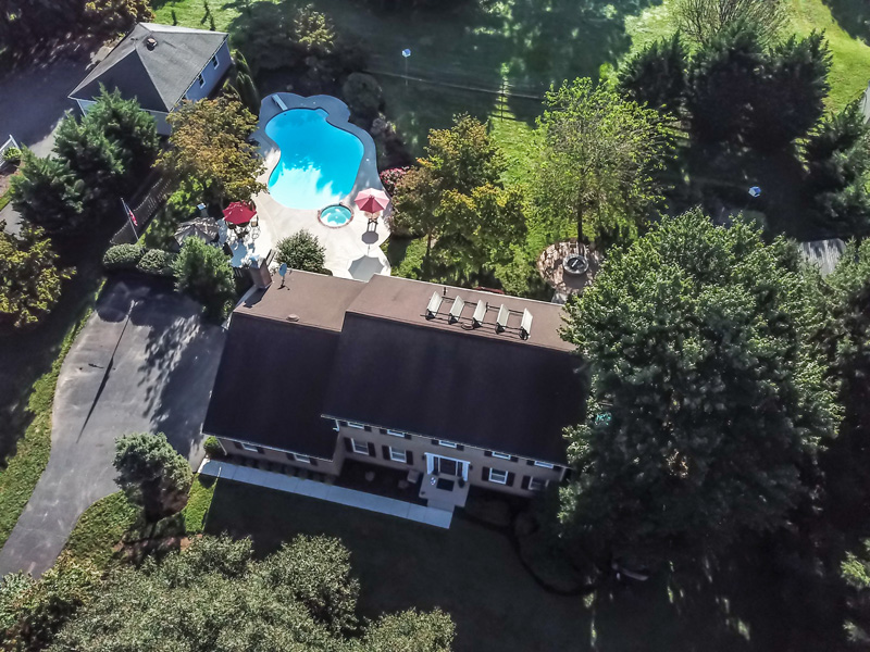 Real Estate Photography, aerial shot of house with pool